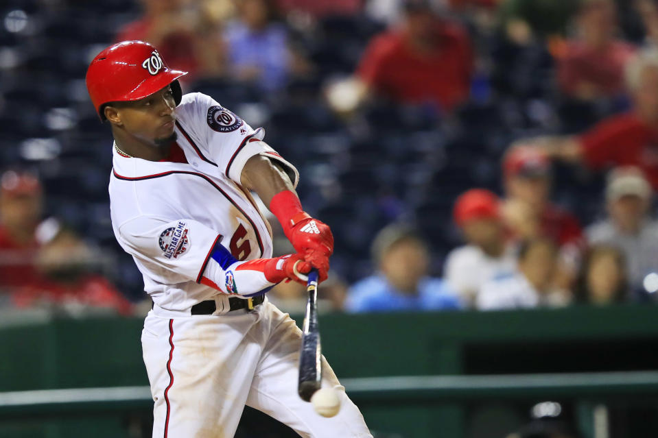Washington Nationals Victor Robles (16) swings his bat and misses during the seventh inning of a baseball game against the Miami Marlins in Washington, Wednesday, Sept. 26, 2018. (AP Photo/Manuel Balce Ceneta)