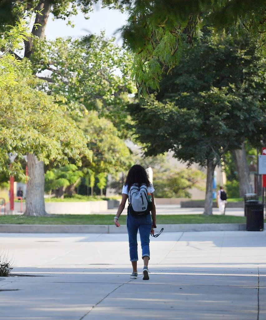 ALBUQUERQUE, NEW MEXICO – AUGUST 17: A student walks on campus classes begin amid the coronavirus (COVID-19) pandemic on the first day of the fall 2020 semester at the University of New Mexico on August 17, 2020 in Albuquerque, New Mexico. To help prevent the spread of COVID-19, the university has moved to a hybrid instruction model that includes a mixture of in-person and remote classes. According to the school, about 70 percent of classes are being taught online. (Photo by Sam Wasson/Getty Images)