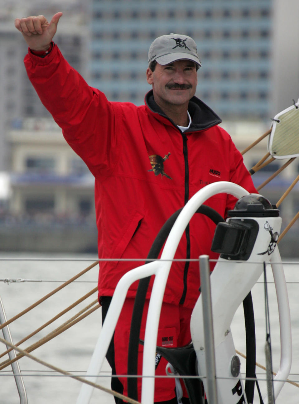 FILE - In this Nov. 12, 2005 file photo Pirates of the Caribbean skipper American Paul Cayard waves as he sails out of the Vigo Harbour, northern Spain prior to the start of the Volvo Ocean Race 2005. Cayard has raced in the America's Cup, the Olympics and was the first American skipper to win one of sailing's toughest challenges, the Whitbread Round the World Race. Now he faces another arduous task, guiding the underperforming U.S. Olympic sailing team as its new executive director. (AP Photo/Lalo R. Villar, File)