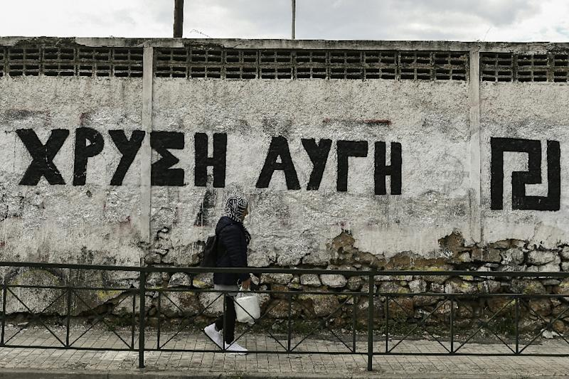 In Athens a wall is painted with the logo of neo-Nazi party Golden Dawn whose four-year-long trial could be nearing conclusion (AFP Photo/Aris MESSINIS)