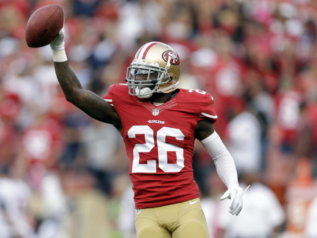 San Francisco 49ers cornerback Tramaine Brock celebrates after scoring a touchdown in the first half of an NFL football game against the Houston Texans in San Francisco, Sunday, Oct. 6, 2013. (AP Photo/Marcio Jose Sanchez)