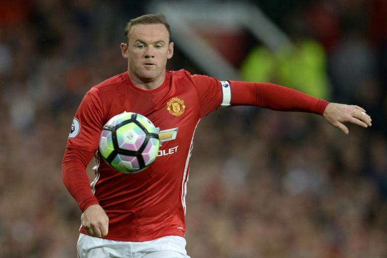 Manchester United striker Wayne Rooney controls the ball during the English Premier League match against Southampton at Old Trafford in Manchester on August 19, 2016