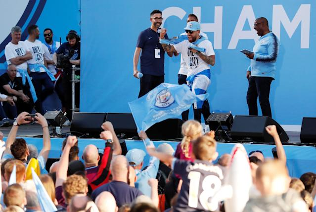 Soccer Football - Premier League - Manchester City Premier League Title Winners Parade - Manchester, Britain - May 14, 2018 Manchester City's Nicolas Otamendi on stage during the parade Action Images via Reuters/Andrew Boyers