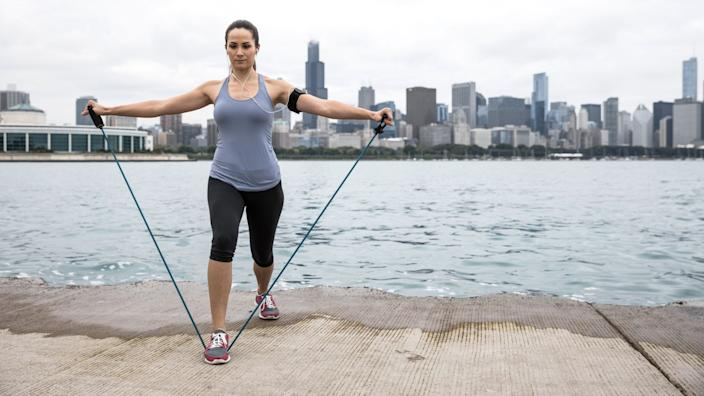Resistance bands can help you tone muscle without acess to a gym. Image via Getty Images.