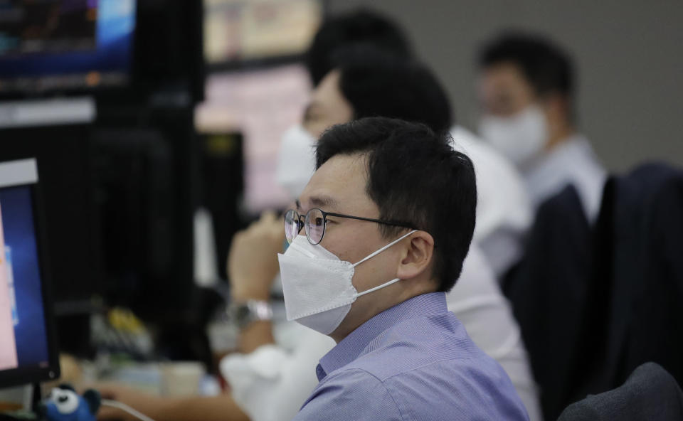 Currency traders watch computer monitors at the foreign exchange dealing room in Seoul, South Korea, Monday, Sept. 28, 2020. Asian shares were mostly higher in muted trading Monday, ahead of the first U.S. presidential debate and a national holiday in China later in the week.(AP Photo/Lee Jin-man)