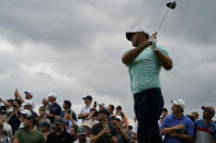 Brooks Koepka watches his shot off the sixth tee in the second round at the Northern Trust golf tournament, Friday, Aug. 20, 2021, at Liberty National Golf Course in Jersey City, N.J. (AP Photo/John Minchillo)