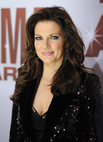 "CORRECTS SPELLING OF AWARDS IN SECOND SENTENCE -- FILE - In this Nov. 9, 2011 file photo, singer Martina McBride arrives at the 45th Annual CMA Awards in Nashville. McBride will perform her new single, ""Marry Me,"" with Train lead singer Pat Monahan while a couple from New Jersey gets married on stage at the Academy of Country Music Awards Sunday April 1, 2012. (AP Photo/Evan Agostini, file)"