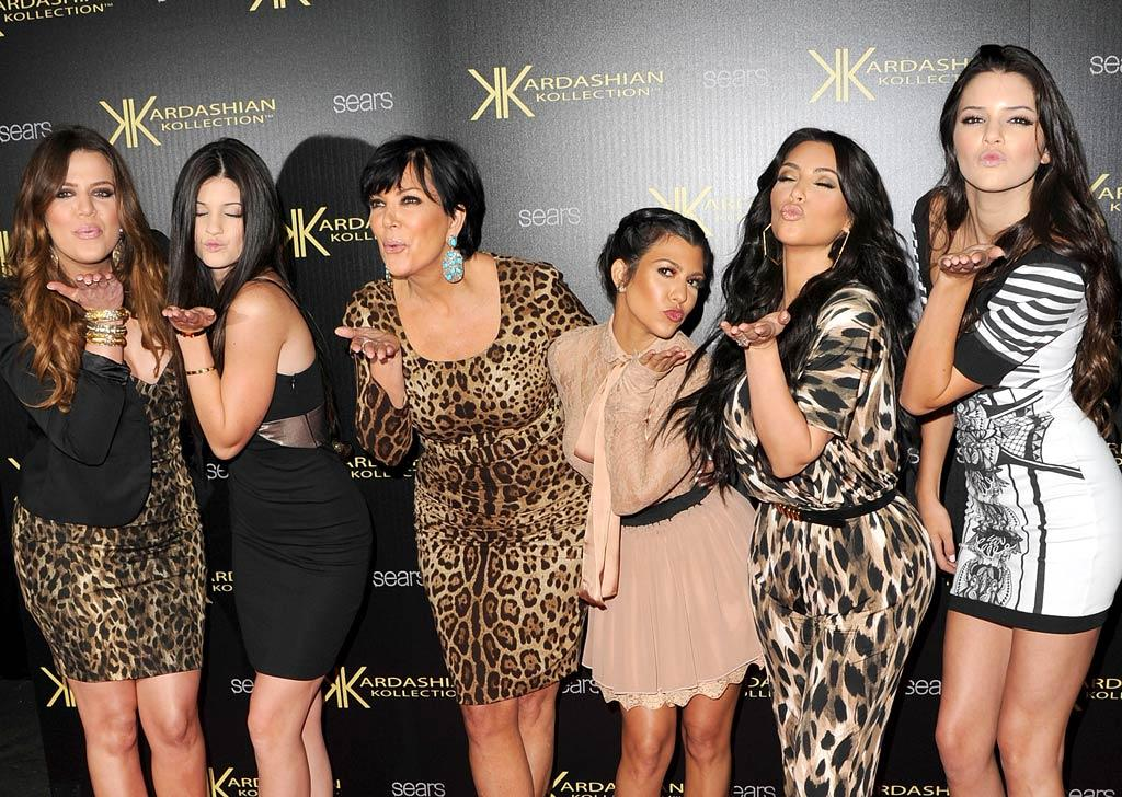 """Later that night, the Kardashian-Jenner clan -- (from left to right) Kylie, Khloe, Kris, Kourtney, Kim, and Kendall -- blew kisses for the cameras at the launch party for the Kardashian Kollection clothing line at Sears. Jason Merritt/<a href=""""http://www.gettyimages.com/"""" target=""""new"""">GettyImages.com</a> - August 17, 2011"""