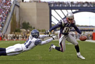 FILE - In this Oct. 17, 2004, file photo, New England Patriots wide receiver David Patten (86) side steps Seattle Seahawks cornerback Ken Lucas (21) as Patten heads for the end zone during second quarter of an NFL football game in Foxborough Mass. Patten, who caught Tom Brady's first postseason touchdown to help the Patriots win their first Super Bowl, was killed in a motorcycle accident on Thursday night, Sept. 3, 2021, outside of Columbia, S.C., Richard County coroner Naida Rutherford said in a statement. He was 47. Patten played 12 seasons in the NFL after signing as an undrafted free agent with the New York Giants in 1997. (AP Photo/Adam Hunger)