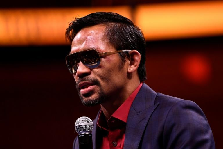 Pacquiao's star power in a country famed for its celebrity-obsessed politics will put him in a strong position in the presidential race (AFP/Patrick T. FALLON)
