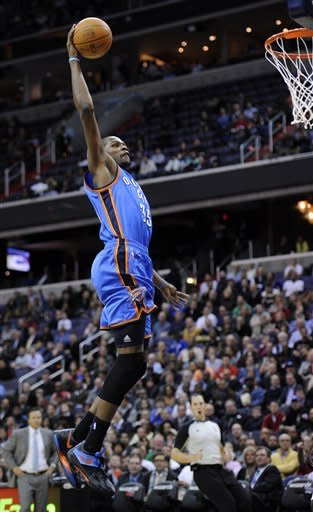Oklahoma City Thunder forward Kevin Durant (35) soars to the basket against the Washington Wizards during the first half of an NBA basketball game on Wednesday, Jan. 18, 2012, in Washington. (AP Photo/Nick Wass)