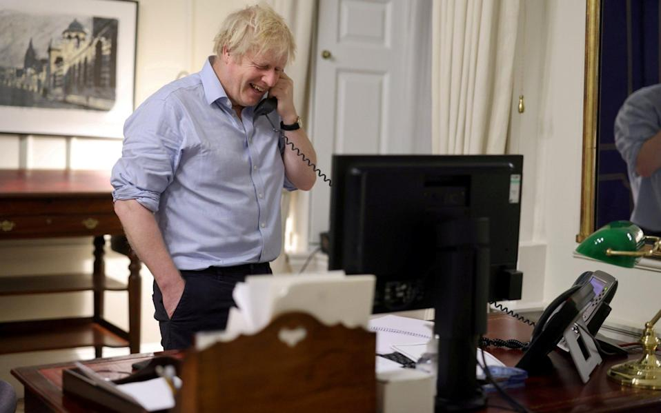 Boris Johnson was one of the first world leaders to speak to President Joe Biden after his inauguration - Reuters