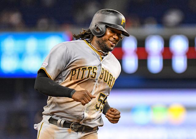 Did you know what team Josh Bell played on before seeing this photo? (Getty Images)