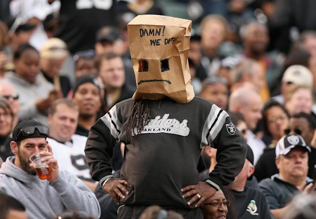 OAKLAND, CA - NOVEMBER 18: An Oakland Raiders fan covers his head with a paper bag during their loss to the New Orleans Saints at O.co Coliseum on November 18, 2012 in Oakland, California. (Photo by Ezra Shaw/Getty Images)