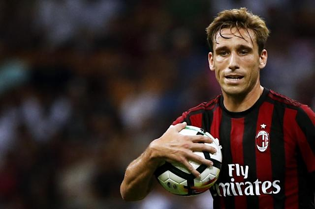 AC Milan's midfielder Lucas Biglia, pictured in 2017, has fractured two vertebrae in his back (AFP Photo/Marco BERTORELLO)