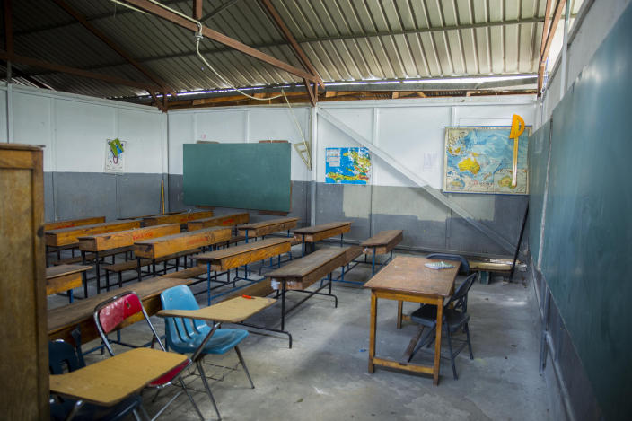 A empty classroom sits empty of students at a Catholic school in the Croix-des-Bouquets neighborhood of Port-au-Prince, Haiti, Wednesday, April 21, 2021. Catholic institutions including schools and universities closed Wednesday across Haiti as part of a three-day protest to demand the release of nine people including five priests and two nuns kidnapped more than a week ago amid a spike in violence the government is struggling to control. (Photo Joseph Odelyn)