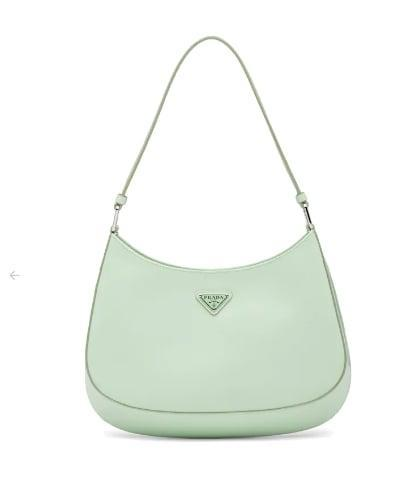 <p>Nothing quite evokes '90s nostalgia like the <span>Prada Cleo brushed-leather shoulder bag</span> ($1,990). Dress this ladylike bag down with your favorite sweatshirt and sneakers.</p>