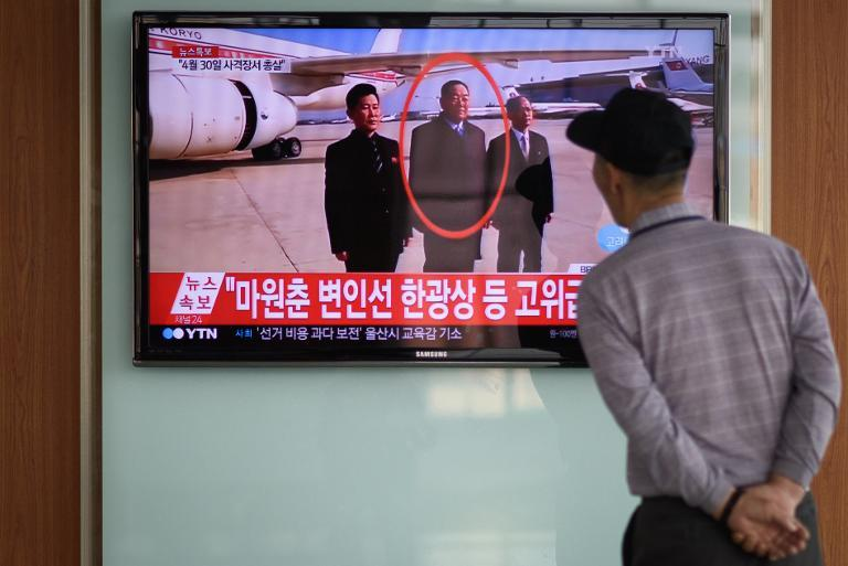 A passer-by watches TV at a railway station in Seoul, showing news coverage of the reported execution of North Korea's defence minister Hyon Yong-Chol, on May 13, 2015