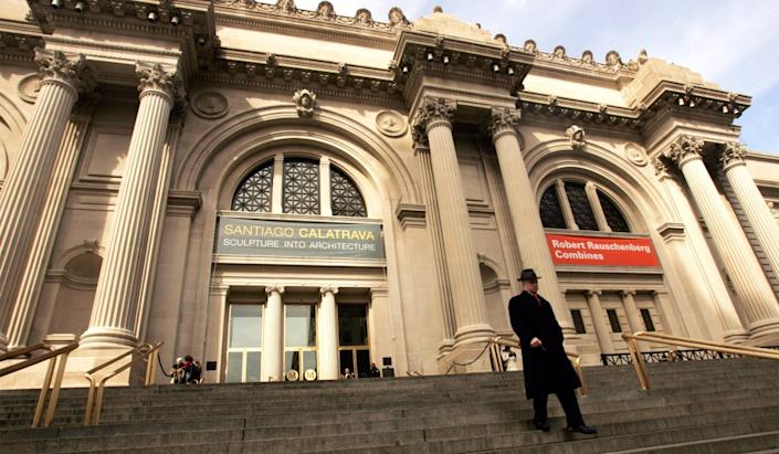 A visitor walks down the steps of the Metropolitan Museum of Art in New York in 2006.