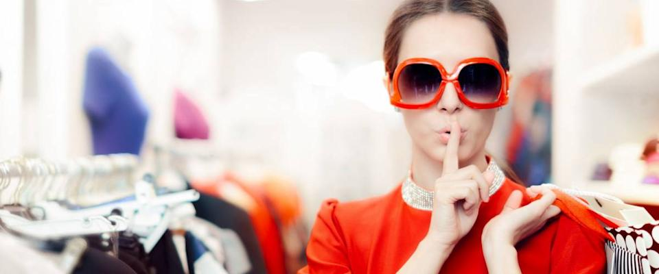 Shopping with Big Sunglasses Woman Keeping a Secret - Cool mysterious girl with shopping bags undercover