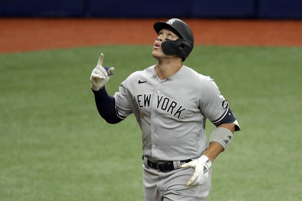 New York Yankees' Aaron Judge celebrates after hitting a two-run home run off Tampa Bay Rays pitcher Sean Gilmartin during the sixth inning of the first game of a doubleheader baseball game Saturday, Aug. 8, 2020, in St. Petersburg, Fla. (AP Photo/Chris O'Meara)