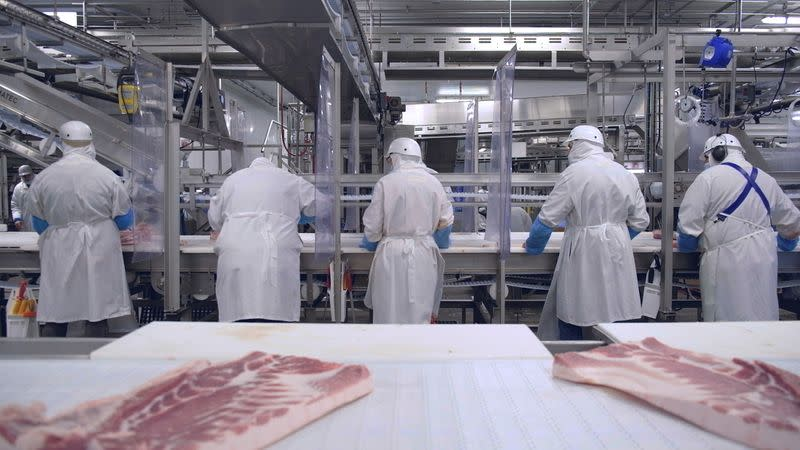 Olymel employees work in one of the companyÕs Quebec hog-slaughtering plants