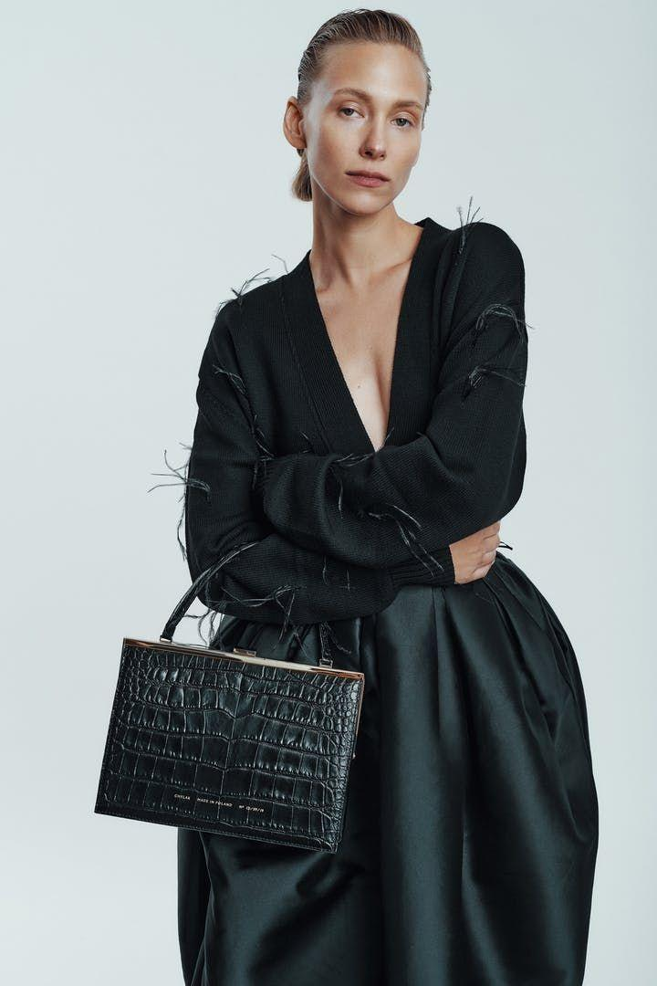 """<p><strong>$660.00</strong></p><p><a href=""""https://chylak.com/us/en/bags/vintage-clasp-bag-glossy-black-crocodile"""" rel=""""nofollow noopener"""" target=""""_blank"""" data-ylk=""""slk:Shop Now"""" class=""""link rapid-noclick-resp"""">Shop Now</a></p><p>The details on this bag harken back to a bygone era. From the clasp, to the croc embossment, the gloss on this structured bag cannot be beat. You can wear it to a cocktail party or a formal event or even with jeans. </p>"""