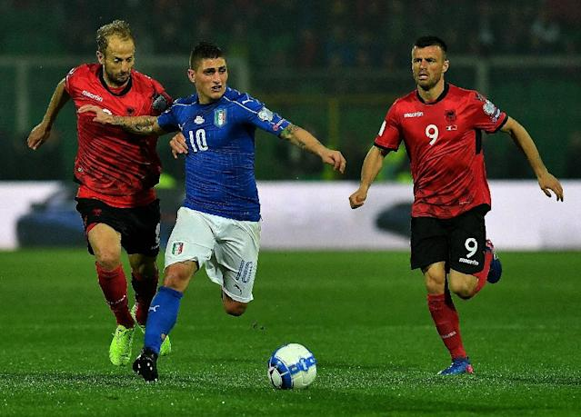 Italy's midfielder Marco Veratti (C) fights for the ball with Albania's defender Naser Aliji (L) and midfielder Ledian Memushaj during the FIFA World Cup 2018 qualification football match March 24, 2017 (AFP Photo/ALBERTO PIZZOLI)