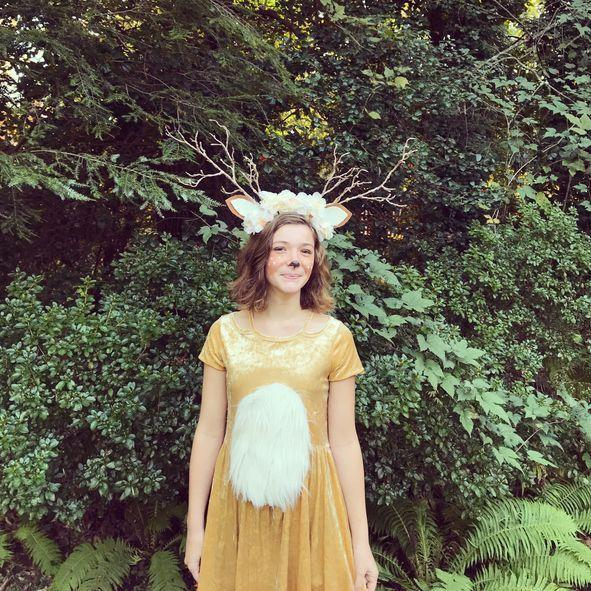 """<p>To take on this endearing costume, glue or pin a large piece of white fur to the front of a tawny-colored dress. Then, craft a headpiece using cutout ears, fake flowers, and twigs. </p><p><a class=""""link rapid-noclick-resp"""" href=""""https://www.amazon.com/R-Vivimos-Womens-Summer-Crushed-Dresses/dp/B01N5JKCU5?tag=syn-yahoo-20&ascsubtag=%5Bartid%7C10070.g.490%5Bsrc%7Cyahoo-us"""" rel=""""nofollow noopener"""" target=""""_blank"""" data-ylk=""""slk:SHOP TAWNY DRESSES"""">SHOP TAWNY DRESSES</a></p>"""