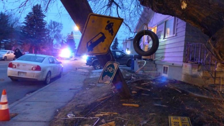 Police seek suspects after stolen truck plows through yard at 22nd St. and Ave. T