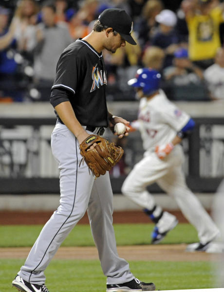 Miami Marlins pitcher Brad Hand, left, reacts as New York Mets' Andrew Brown, right, rounds the bases with a home run during the second inning of a baseball game on Friday, Sept. 13, 2013, in New York. (AP Photo/Bill Kostroun)
