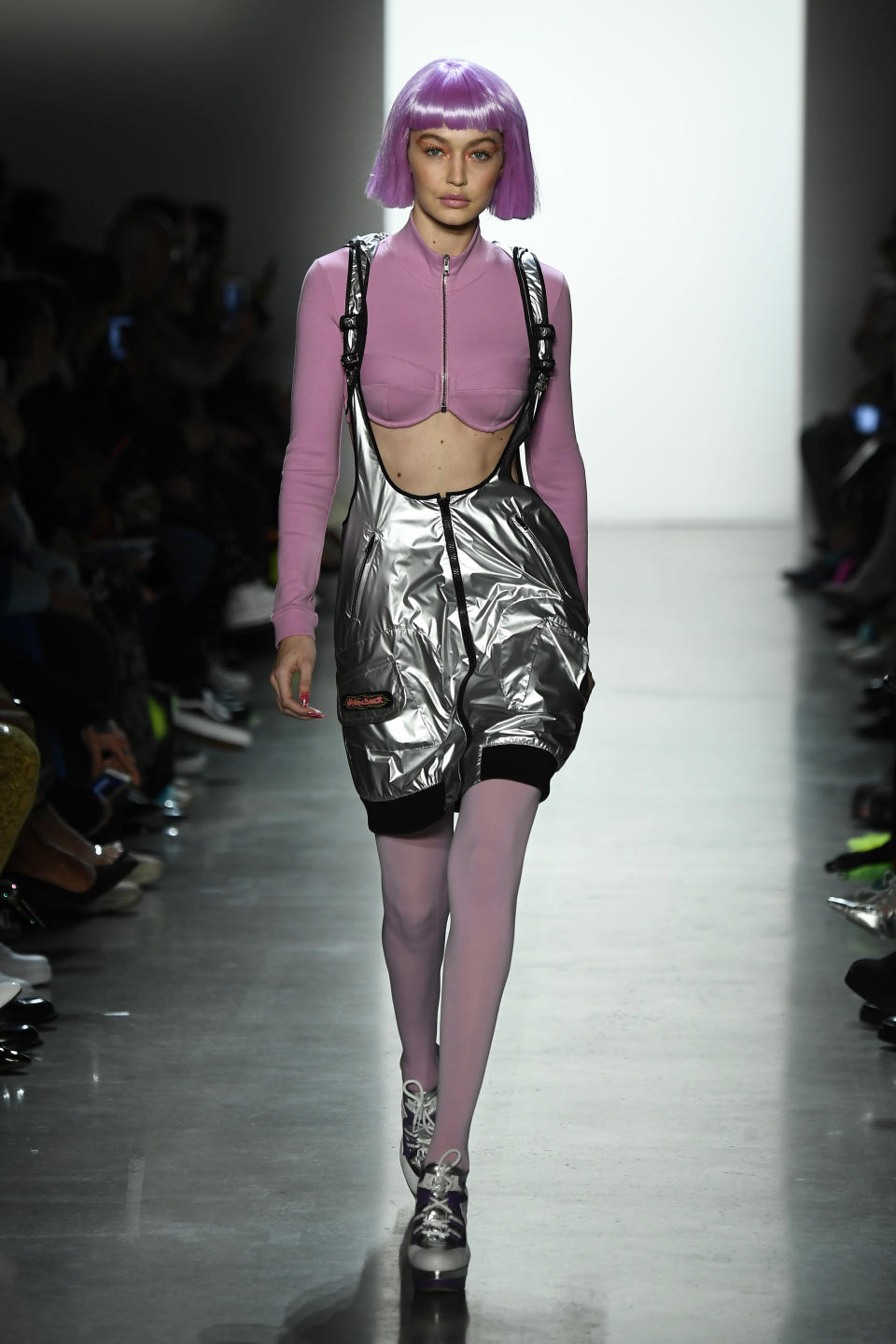 <p>The top model proved she really can work any hairstyle in a bubblegum pink chin-grazing wig on the Jeremy Scott catwalk. <em>[Photo: Getty]</em> </p>
