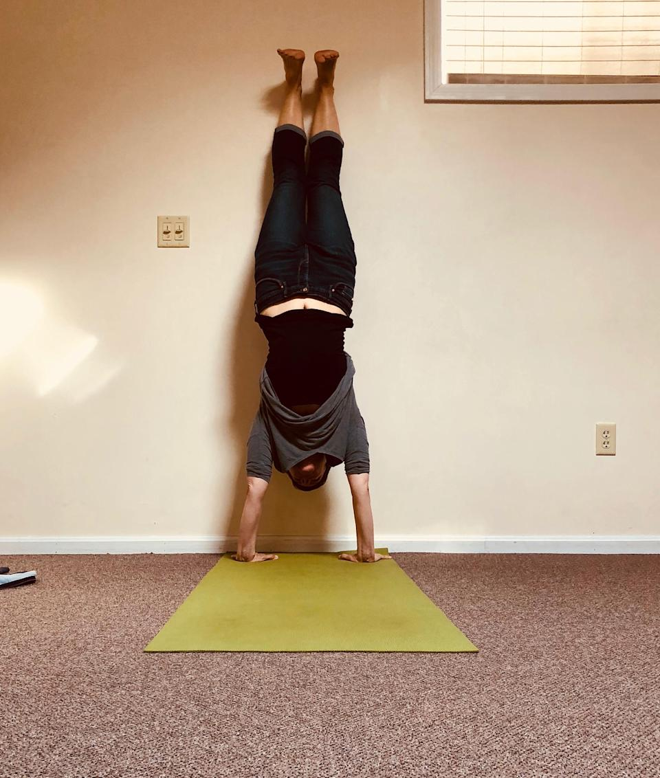 The author in a recent handstand. (Photo: Courtesy Catherine Guthrie)