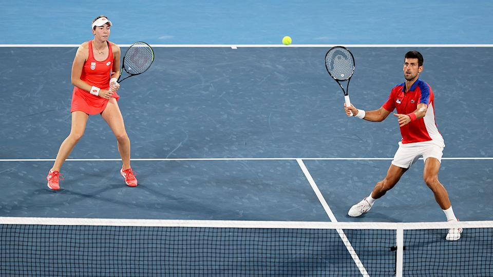 Nina Stojanovic and Novak Djokovic, pictured here in action in mixed doubles at the Olympics.