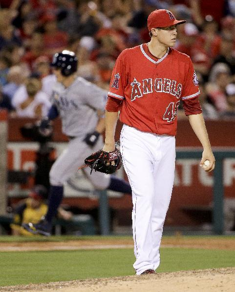 Los Angeles Angels starting pitcher Tyler Skaggs looks away after giving up a home run to Tampa Bay Rays' Brandon Guyer during the seventh inning of a baseball game in Anaheim, Calif., Thursday, May 15, 2014. (AP Photo/Chris Carlson)
