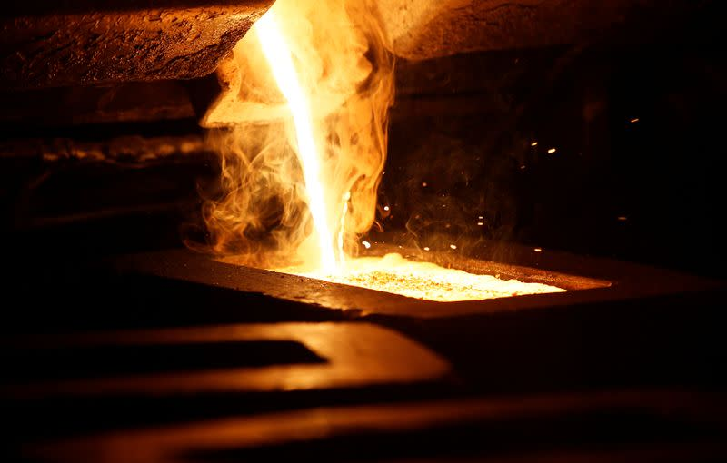 FILE PHOTO: Liquid gold is poured to form gold dore bars at Newmont Mining's Carlin gold mine operation near Elko