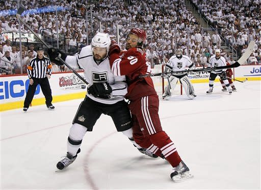 Phoenix Coyotes center Antoine Vermette, right, checks into Los Angeles Kings defenseman Drew Doughty (8) during the first period of Game 2 of the NHL hockey Stanley Cup Western Conference finals, Tuesday, May 15, 2012, in Glendale, Ariz. (AP Photo/Matt York)