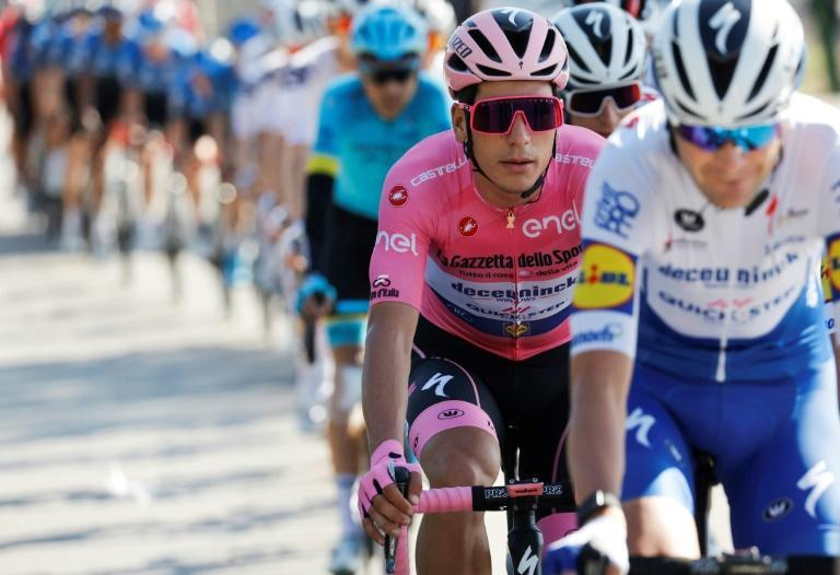 Team Deceuninck rider Portugal's Joao Almeida holds the overall pink jersey.