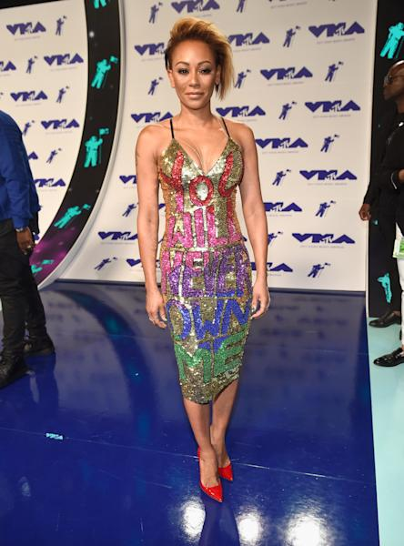 The 'America's Got Talent' star rocked a colorful dress on the red carpet that could be a bold comment about her contentious split.