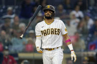 San Diego Padres' Fernando Tatis Jr. flips his bat after striking out during the first inning of a baseball game against the Chicago Cubs, Monday, June 7, 2021, in San Diego. (AP Photo/Gregory Bull)