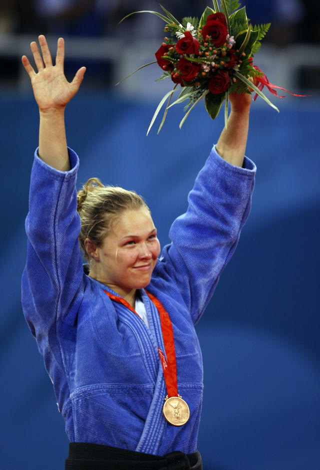 Bronze medalist Ronda Rousey of the United States, celebrates during the medals ceremony for the women's -70kg judo middleweight division finals at the Beijing 2008 Olympics in Beijing, Wednesday, Aug. 13, 2008. (AP Photo/Charles Dharapak)