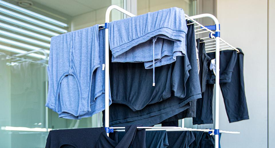 A heated clothes airer will take the stress out of your laundry day. (Getty Images)
