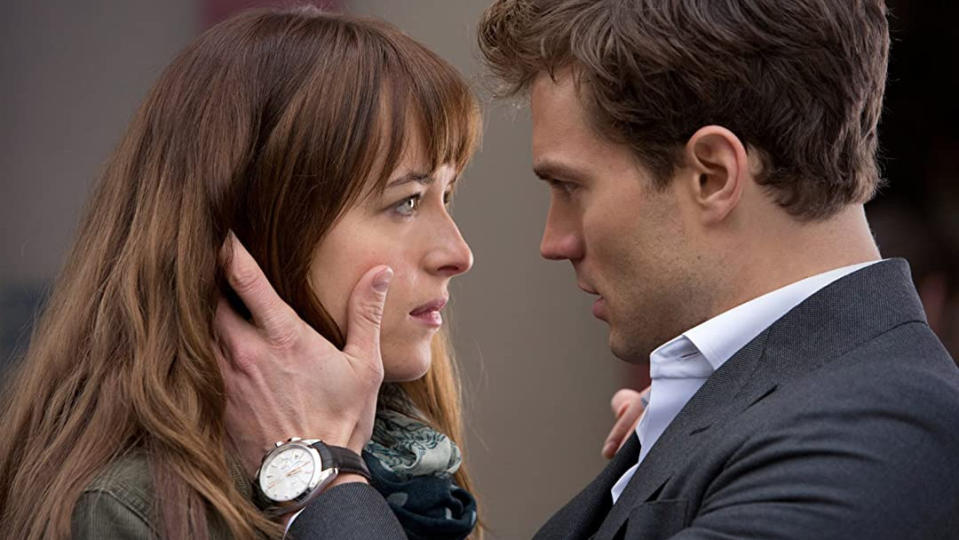 Dakota Johnson and Jamie Dornan in 'Fifty Shades of Grey'. (Credit: Universal)