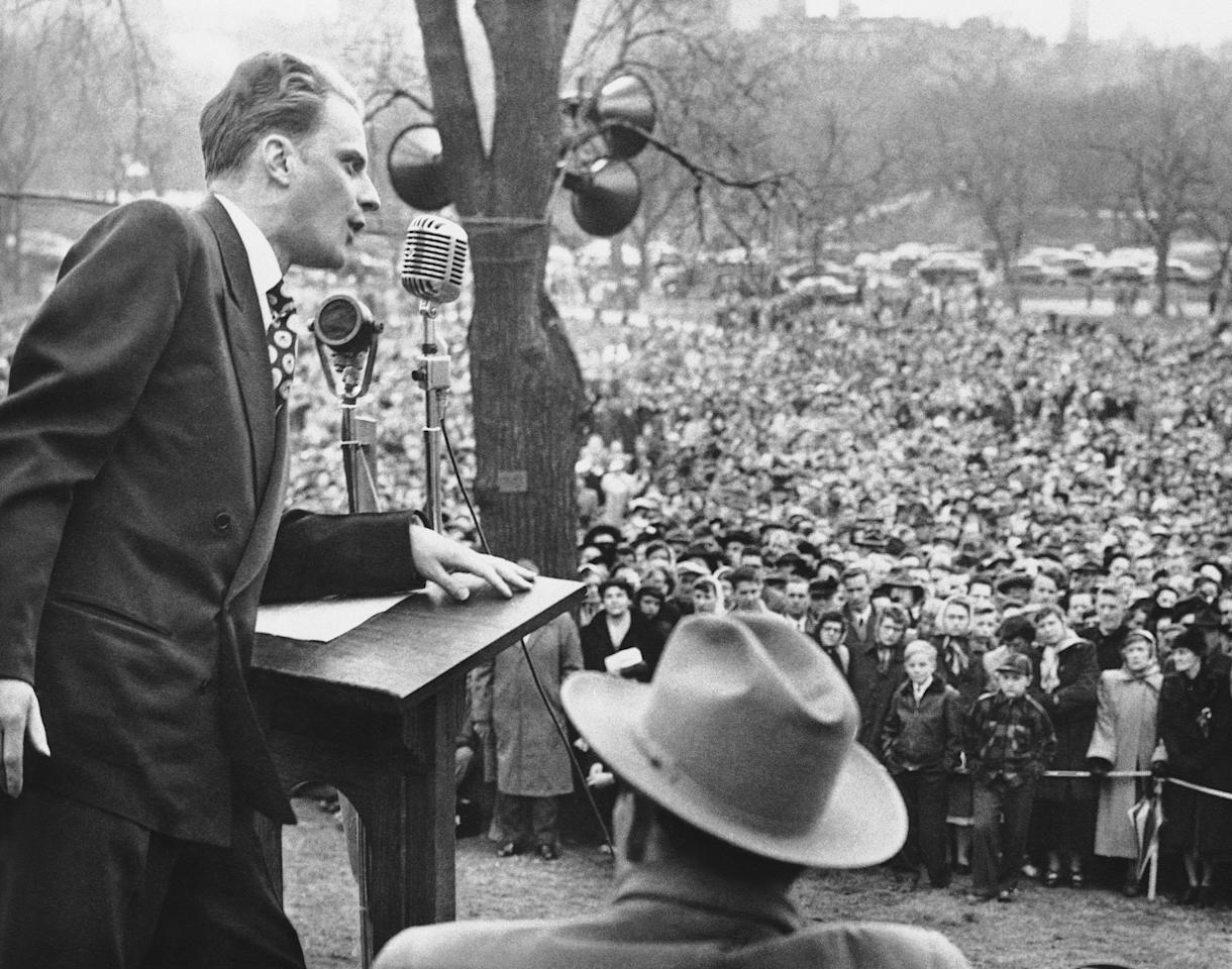 <p>The Rev. Billy Graham, crusading Evangelist, ended a tour of New England with a mass rally on historic Boston Common on April 23, 1950. Despite the cold weather, police estimated that 50,000 people attended the event. (Photo: AP) </p>