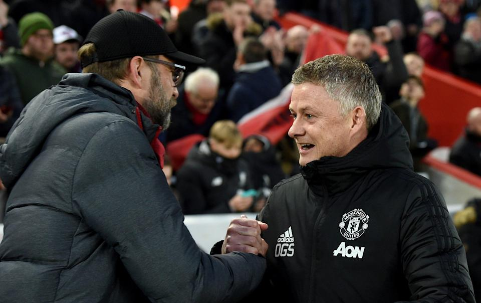Jurgen Klopp and Ole Gunnar Solskjaer are at odds over the number of penalties Man Utd have been awarded - GETTY IMAGES