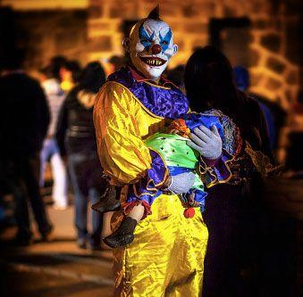 Creepy, whispering clowns have reportedly been spotted lurking in the woods, luring in children. Photo: Getty