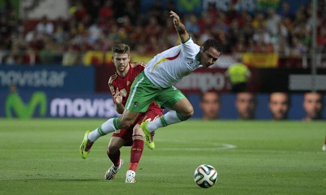 Spain's Alberto Moreno, rear, and Bolivia's Gualberto Mojica, vie for the ball during their friendly soccer match in Seville, on Friday, May 30. 2014. (AP Photo/Miguel Angel Morenatti)