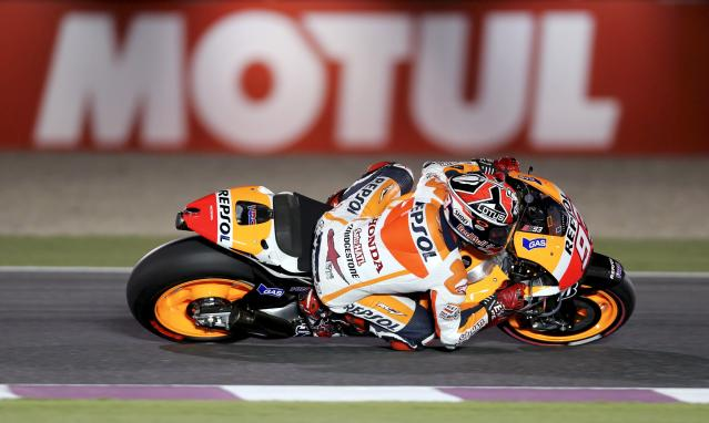 Honda MotoGP rider Marc Marquez of Spain rides his bike during a free practice session at the MotoGP World Championship at the Losail International circuit in Doha March 21, 2014. REUTERS/Fadi Al-Assaad (QATAR - Tags: SPORT MOTORSPORT)