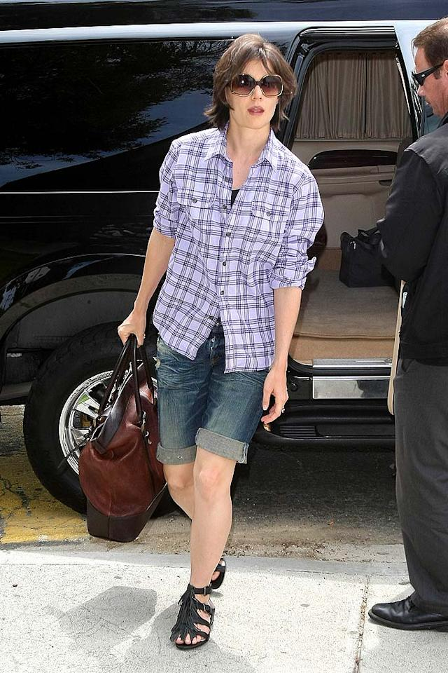 "I'm all for casual comfort, but Katie Holmes should know better than to hit the streets of NYC in a Samantha Ronsonesque plaid top, cuffed denim shorts, pale legs, and strappy gladiator sandals. Clint Brewer/<a href=""http://www.splashnewsonline.com"" target=""new"">Splash News</a> - April 13, 2009"