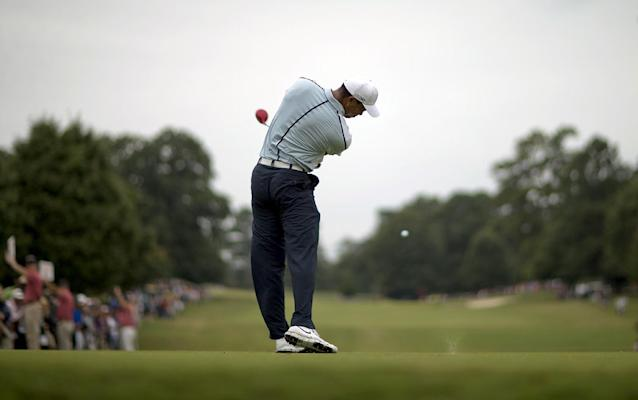 Tiger Woods tees off the seventh hole during the third round of play in the Tour Championship golf tournament at East Lake Golf Club, in Atlanta, Saturday, Sept. 21, 2013. (AP Photo/David Goldman)